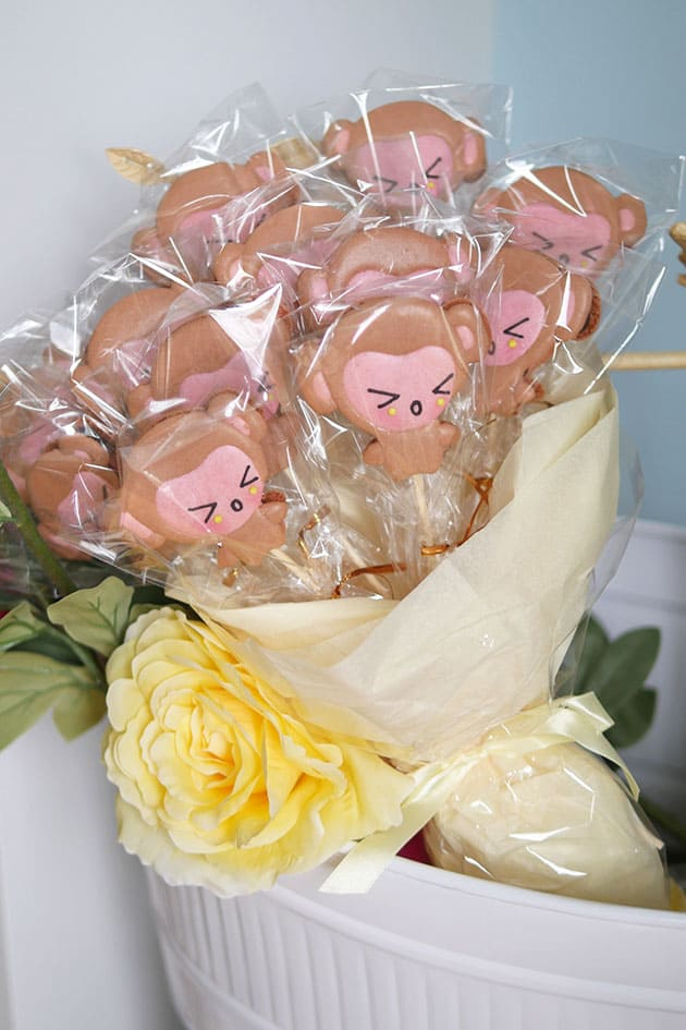 Monkey shaped macarons individually wrapped in a bouquet.