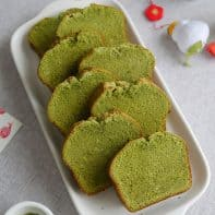 8 slices of matcha pound cake on a long serving dish.