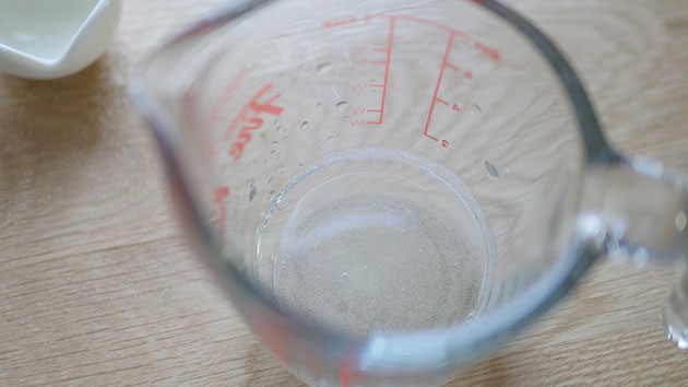 Gelatin has become liquid inside a measuring cup.