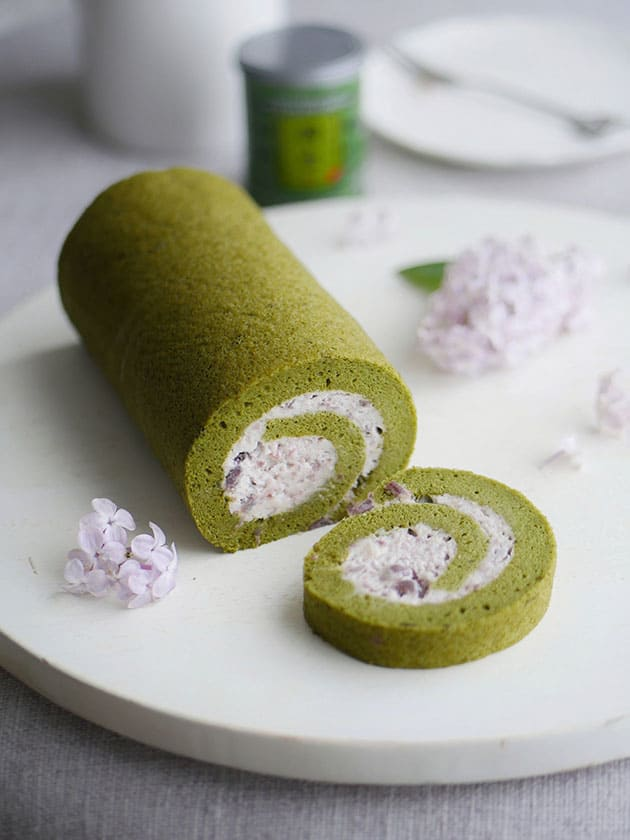 A matcha cake roll filled with red bean whipped cream.