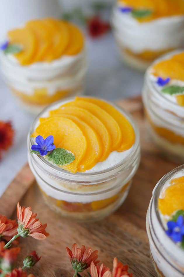 Close up shot of peach cakes in a cup.
