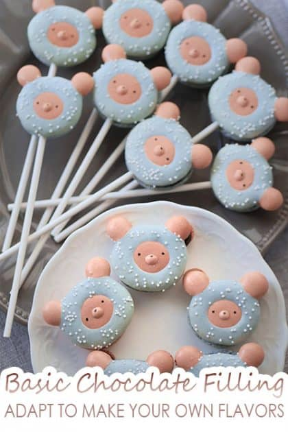 Winter bear macarons on lollipop sticks.