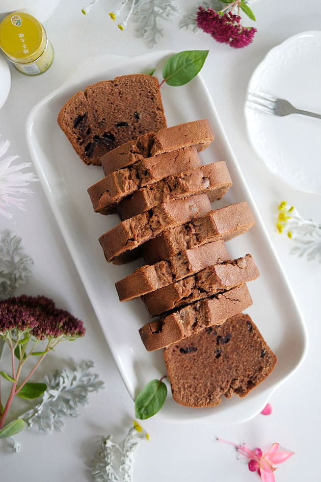 Chocolate pound cake slices in staggered pattern as shot from above to show top of cake.