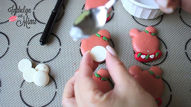 Snout being added onto Christmas bear macaron.