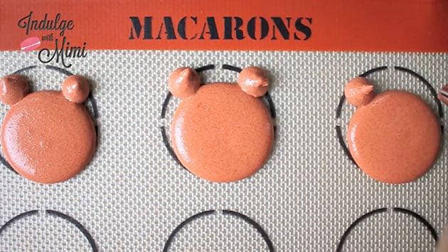 Macaron batter that looks like a bear shape.