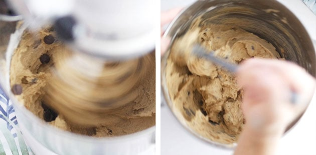 Chocolate chip cookie added to a cookie batter that is being mixed. Hand folding batter down.