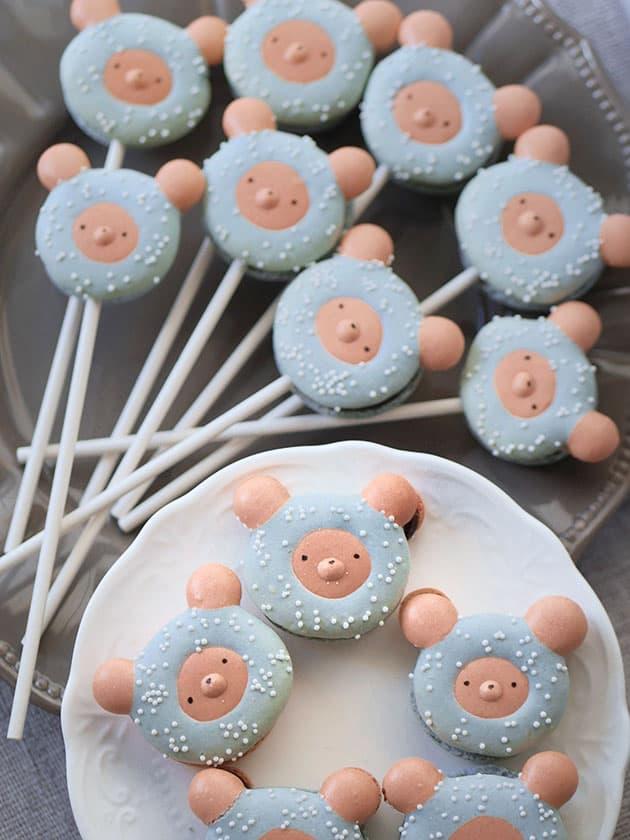 Bear macaron lollipops on a plate.