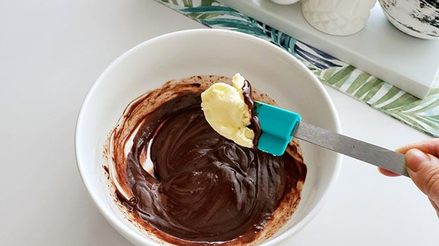 Butter being added to chocoalate macaron filling.