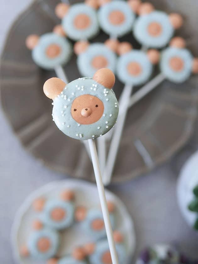 Close up of a bear macaron lollipop.