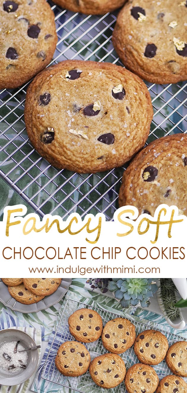 Large chocolate chip cookies with gold flakes cooling on a cooling rack.