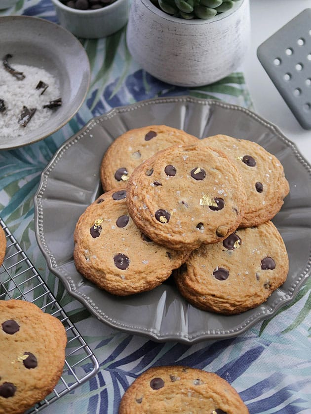 Fancy soft chocolate chip cookies on a plate.