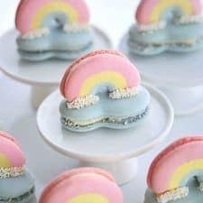 3D rainbow macarons perched on top of a cloud macaron.