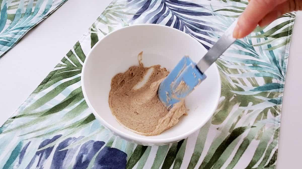 Mini spatula blending the filling.