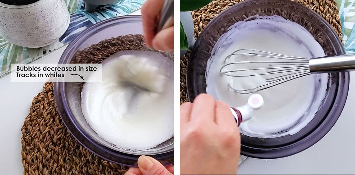 A hand dropping food coloring into a bowl filled with meringue.