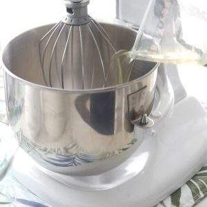 Mixing bowl attached to a stand mixer on a counter.