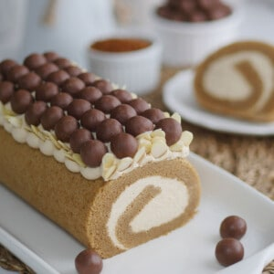 Coffee cake roll filled with Kaluha cream with some slices in the background.