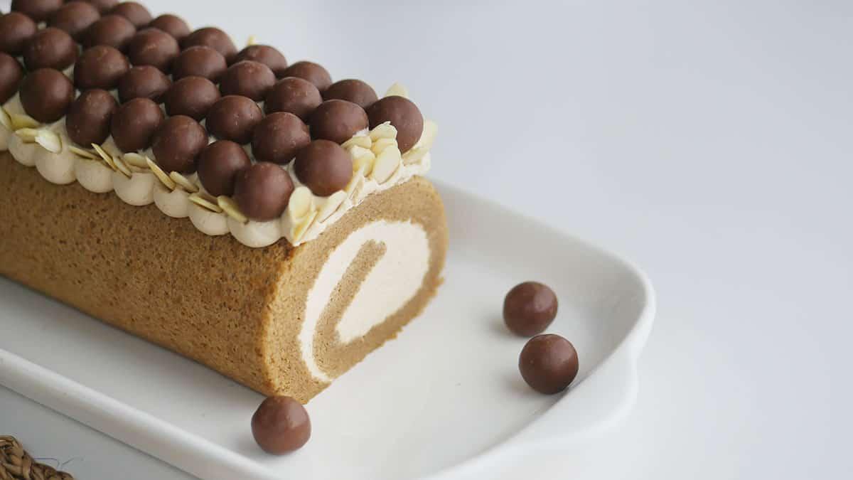 Coffee cake with Kaluha cream on a long white plate.
